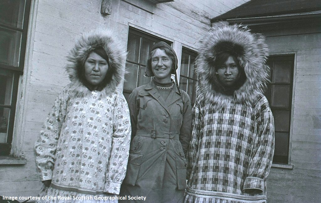 Artic explorer Isobel Hutchison poses with two Alaskan nurses wearing large fur hoods