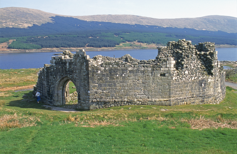 An 11-sided castle reconstructed in front of the loch where it was originally located on an island