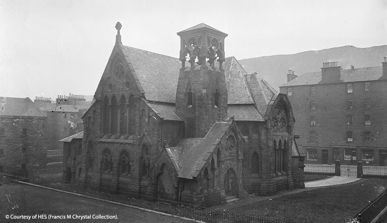 Black and white image of an eccentric looking church in ththe Victorian High Gothic revival style