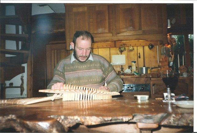 Tim Stead sculpting at a kitchen table in The Steading