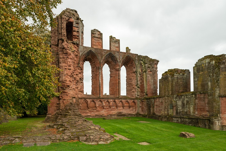 Three large arched windows in the ruins of Arbroath Abbey