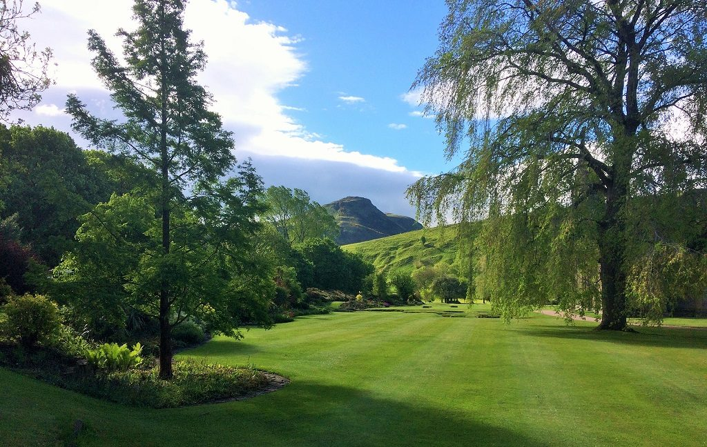 A view towards Arthur's Seat across the lawn in the Holyrood Palace garden