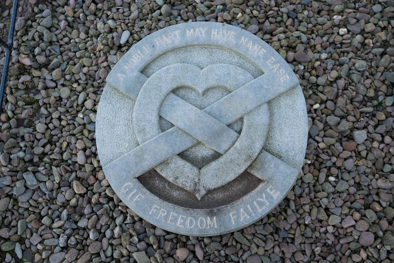 A stone marker featuring a Saltire intertwined with a heart