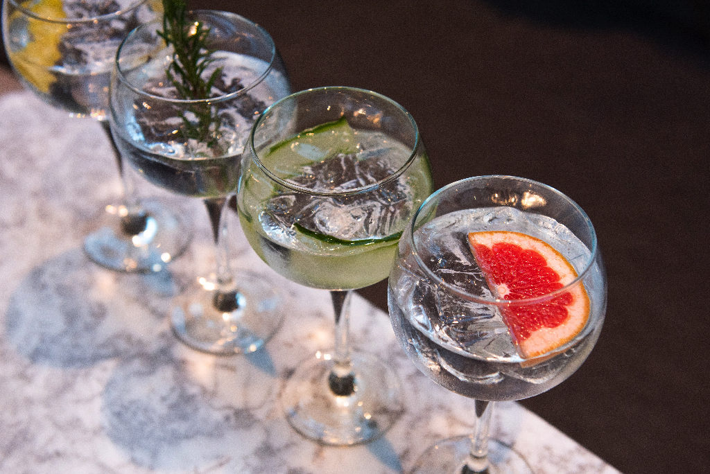 three glasses of gin in balloon glasses