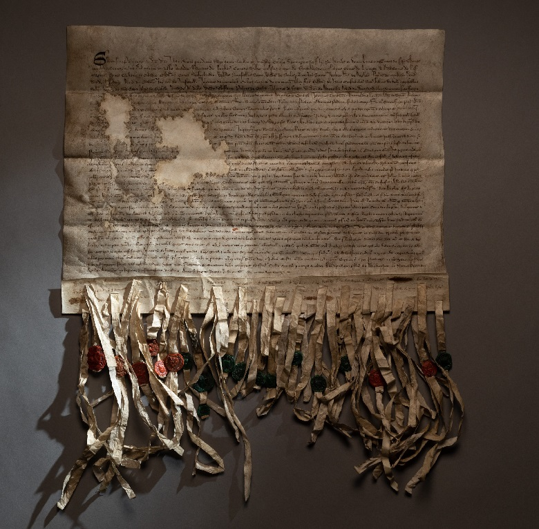 Facsimile of the Declaration of Arbroath. Beneath the text of the letter the various wax seals of the 39 nobles involved are attached