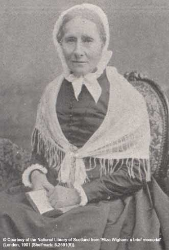 Photo portrait of Eliza Wigham. She is seated, wearing a dark fress with a white shawl tied around her shoulders and a white bonnet tied around her head. Copyright National Library of Scotland.