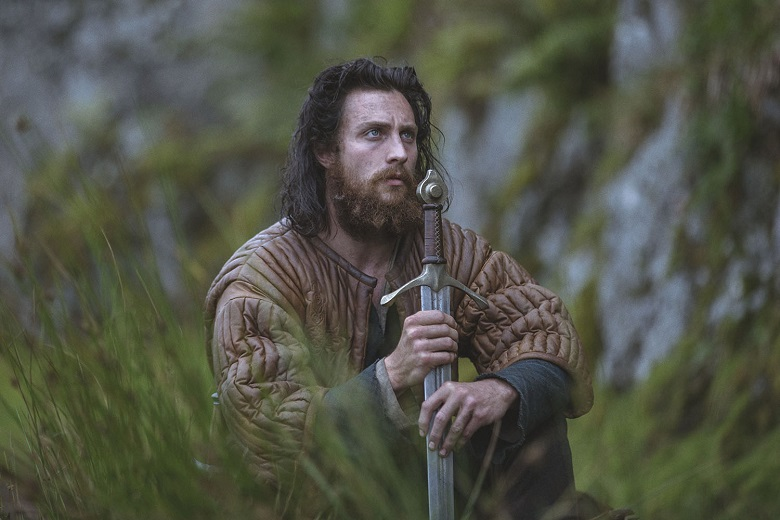 An actor portraying James Douglas kneeling and holding a sword