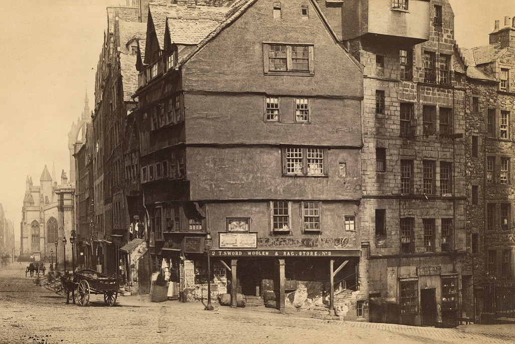 sepia photo showing the Lawnmarket area of Edinburgh. Horses and carts are in the street.