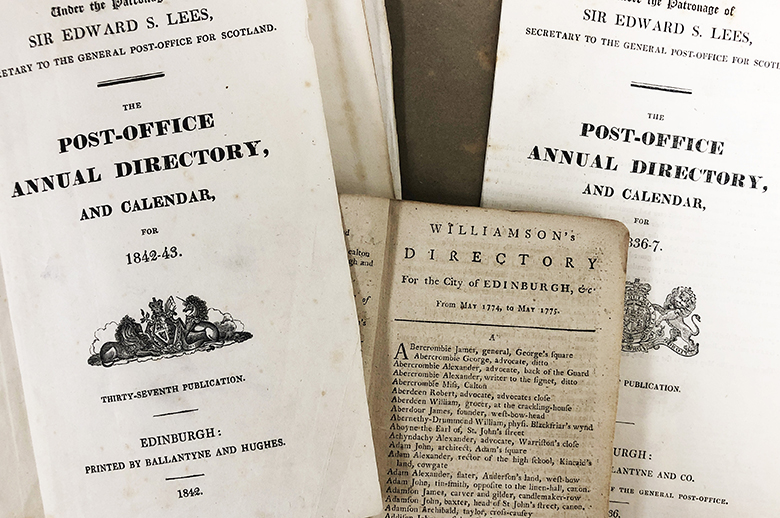 """A photo showing the covers of several old directories. The first reads: """"The Post-Office Annual Directory and Calendar for 1842-43."""""""