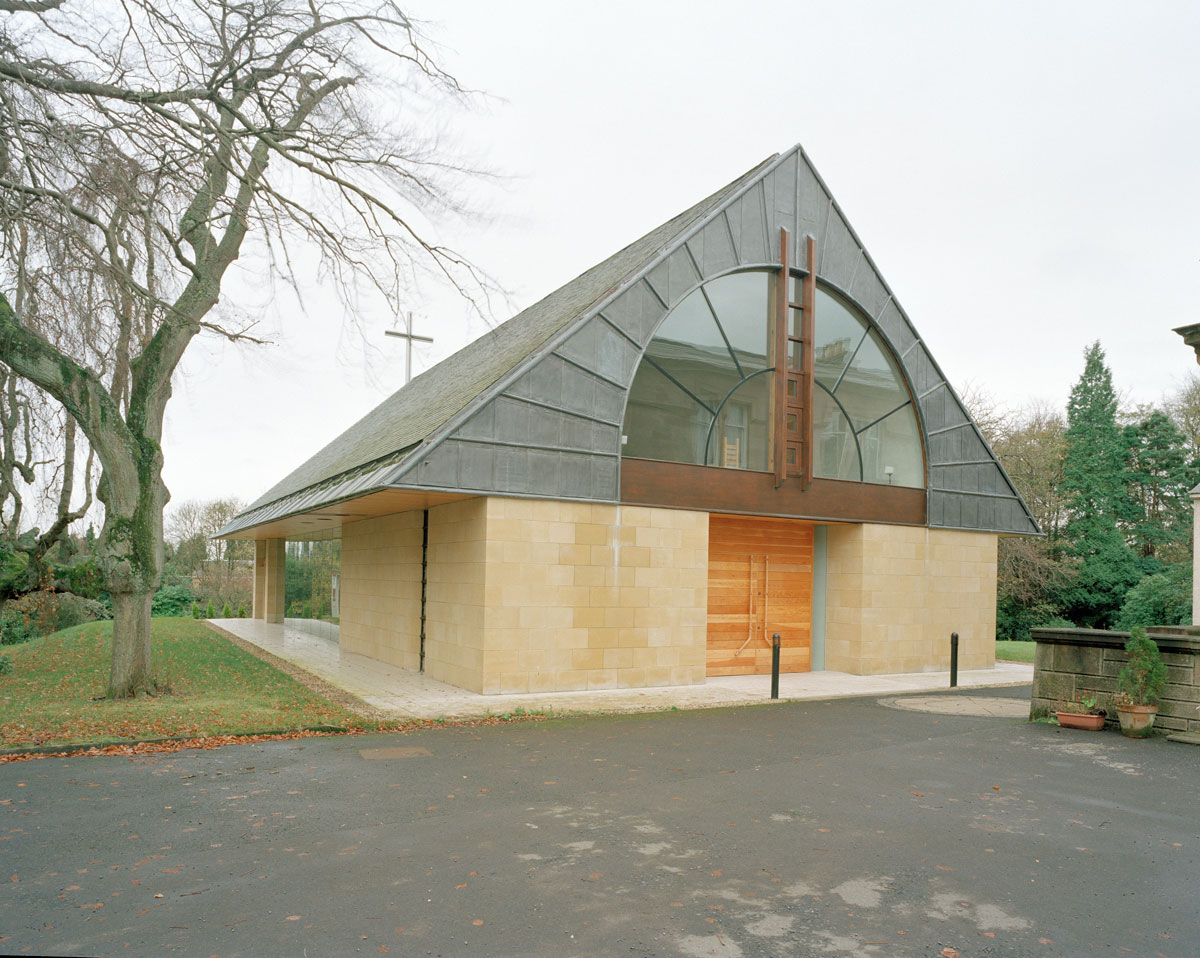 postmodern chapel building with sloped roof and large arched window