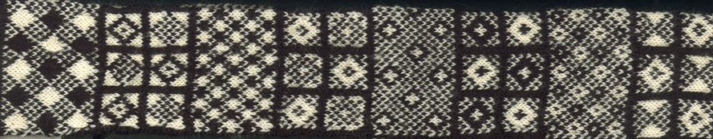 A piece of knitted fabric made of lots of different patterns.