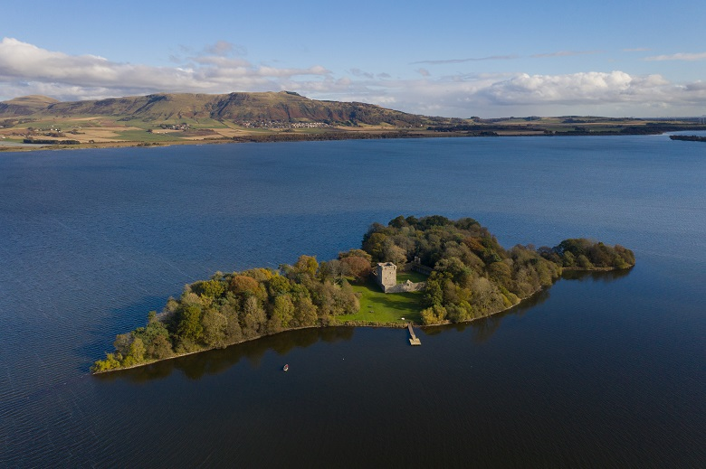 An aerial image of Lochleven Castle showing its location on a small island in the centre of a loch
