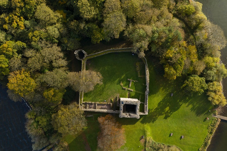 A drone photo taken directly above the ruins of Lochleven Castle showing its defensive walls and tower