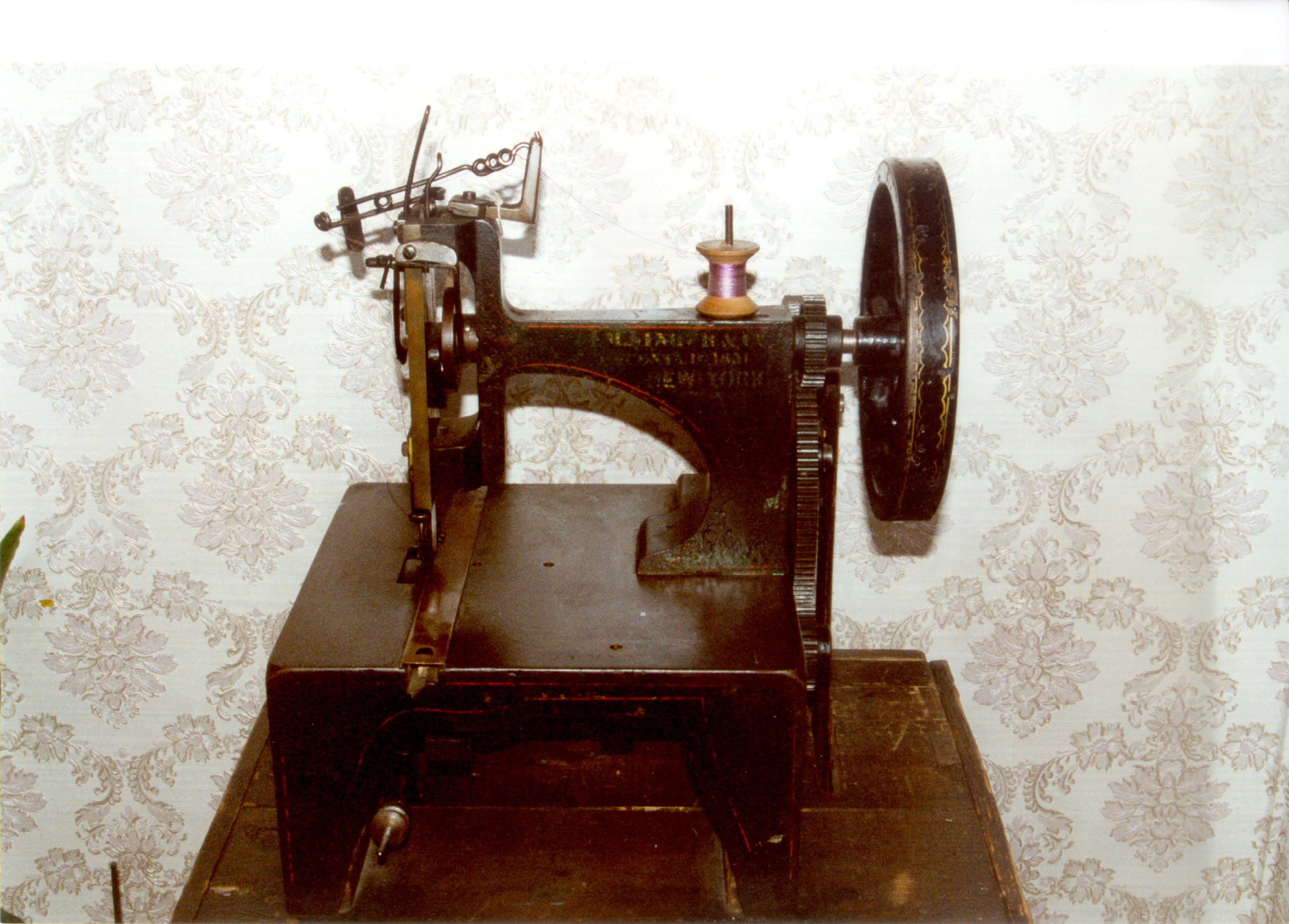 perpendicular action sewing machine manufactured by the Singer Company for use mainly in factories