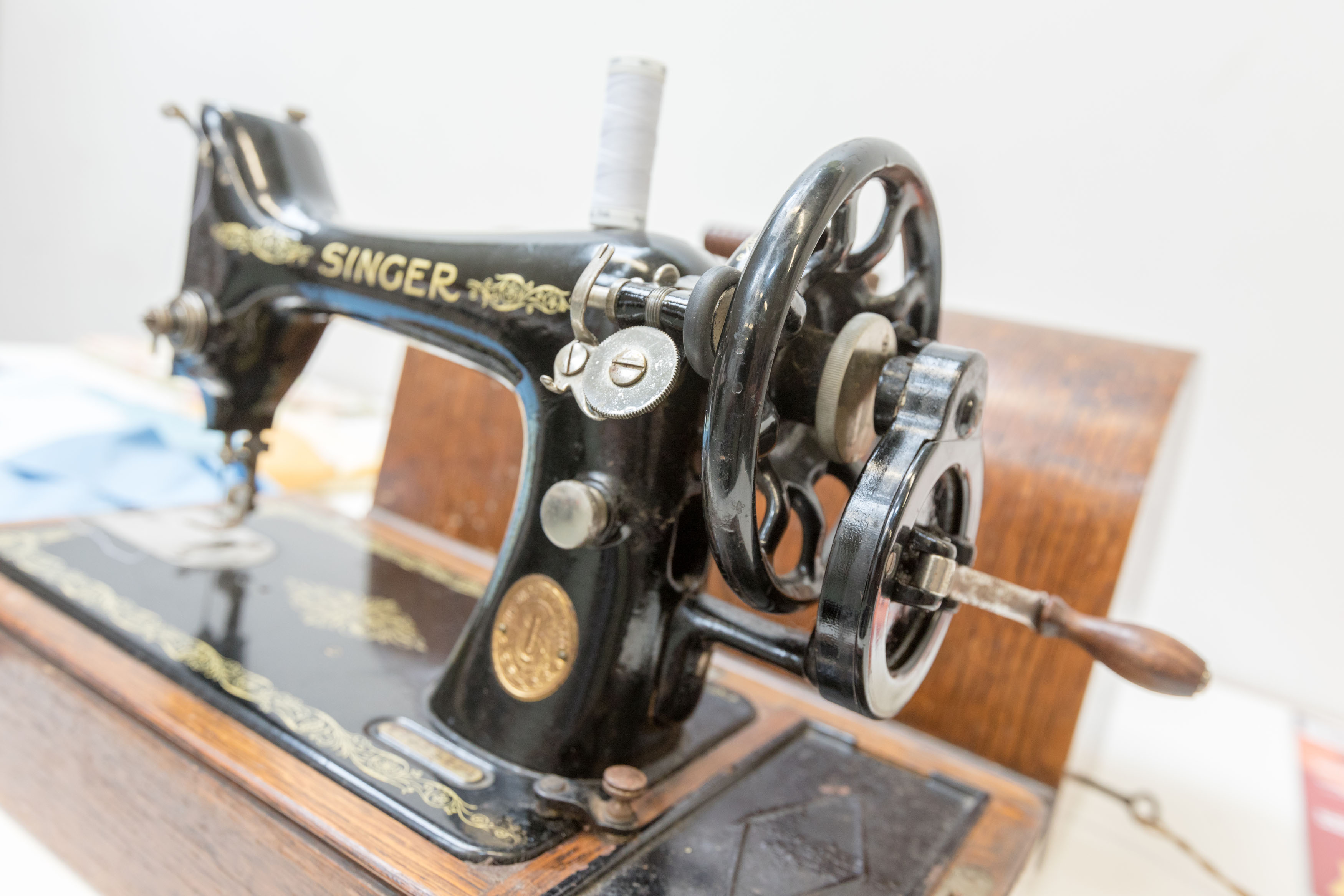 cast iron sewing machine in an iconic Singer design with flakes of nickel on the exterior