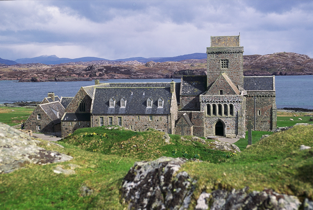 a Benedictine abbey with the sea in the background