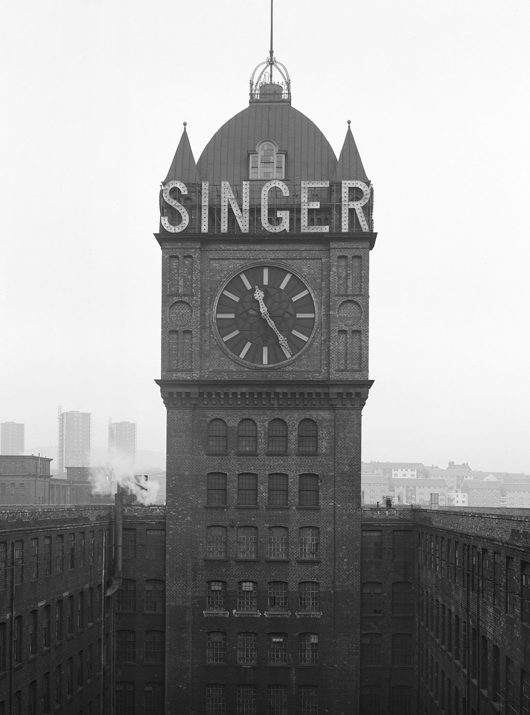 clock tower with 'singer' emblazoned on the roof