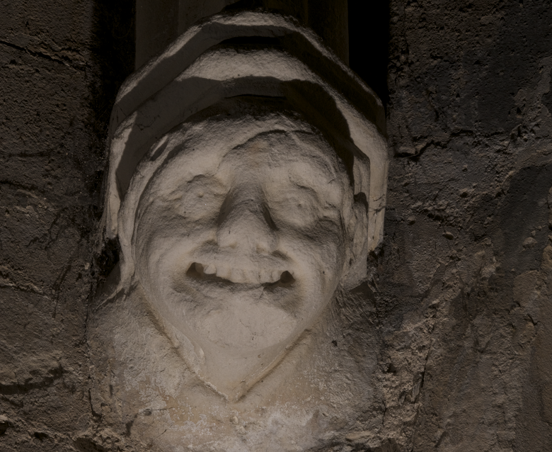 A grimacing stone gargoyle