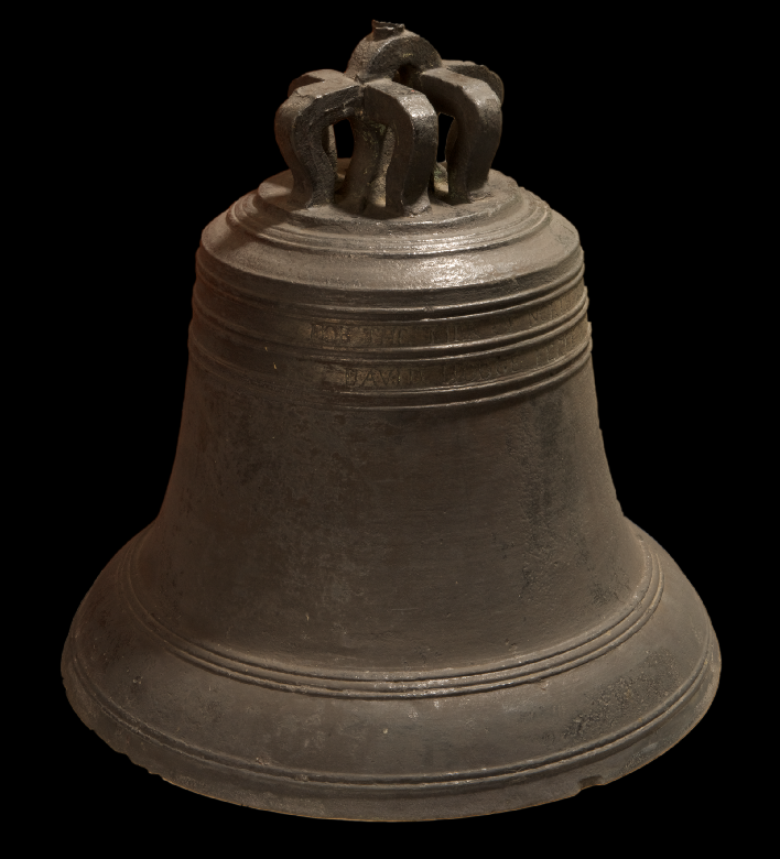 A large metal bell with faint engraved lettering
