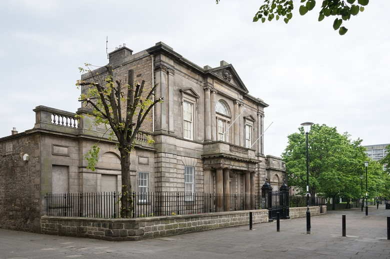 The Georgian exterior of Trinity House surrounded by black metal railings