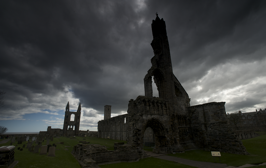 Storm clouds over the ruins of a cathedral