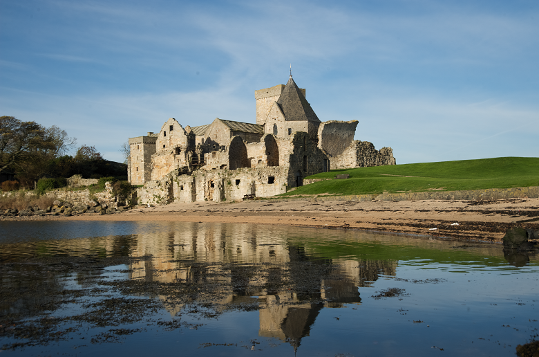 Ruins of an abbey reflected in the sea