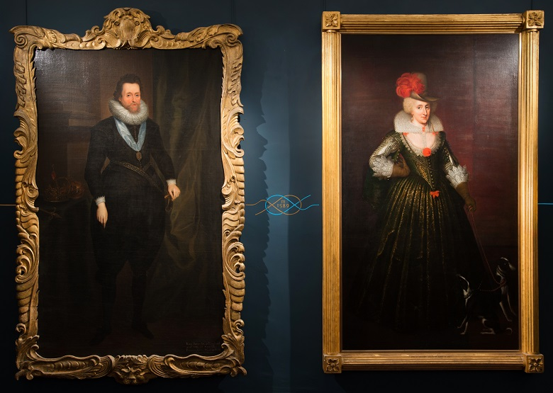 Large portraits of a husband and wife hanging side by side