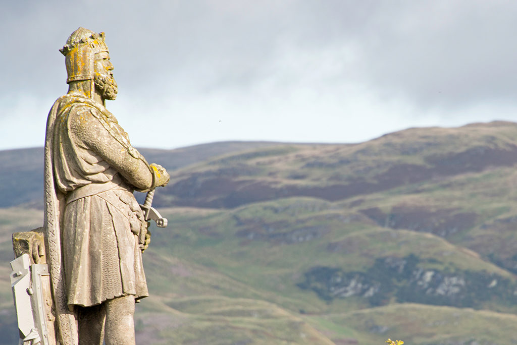 Statue of Robert the Bruce at Stirling Castle looking out over the hills.