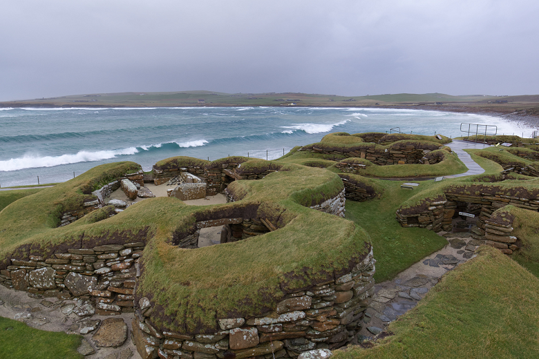 Waves lapping against the shore near the ruins of a prehistoric village