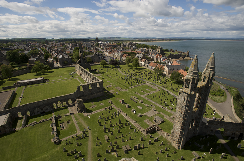 A town and cathedral ruins viewed from above