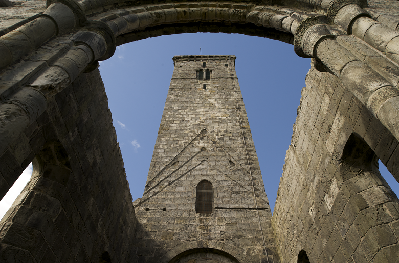 A square tower above the ruins of a cathedral