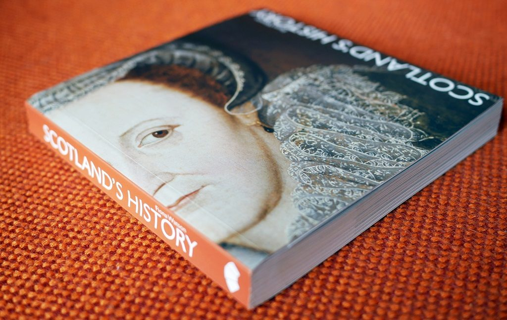 A hardback book called Scotland's History with a cover featuring Mary Queen of Scots