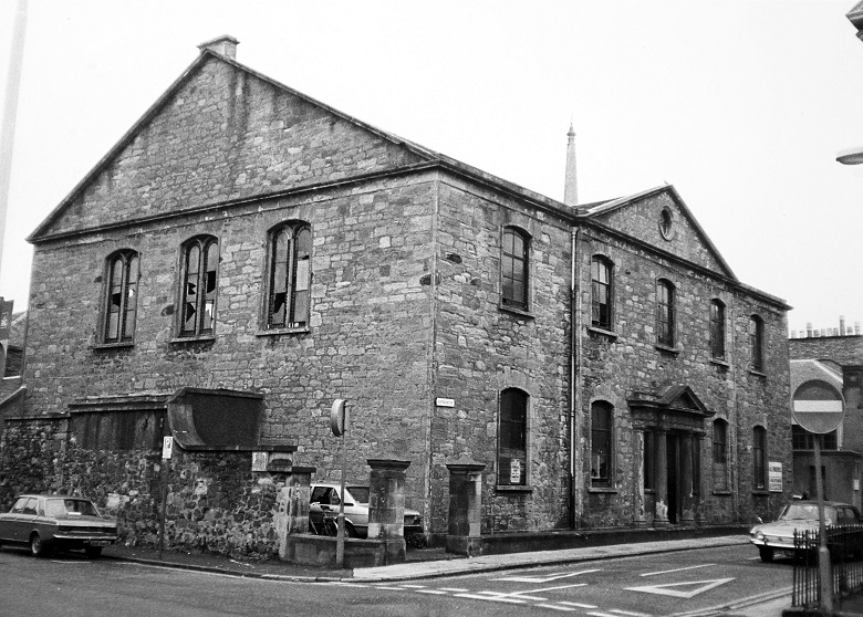 Black and white photo of a former church building