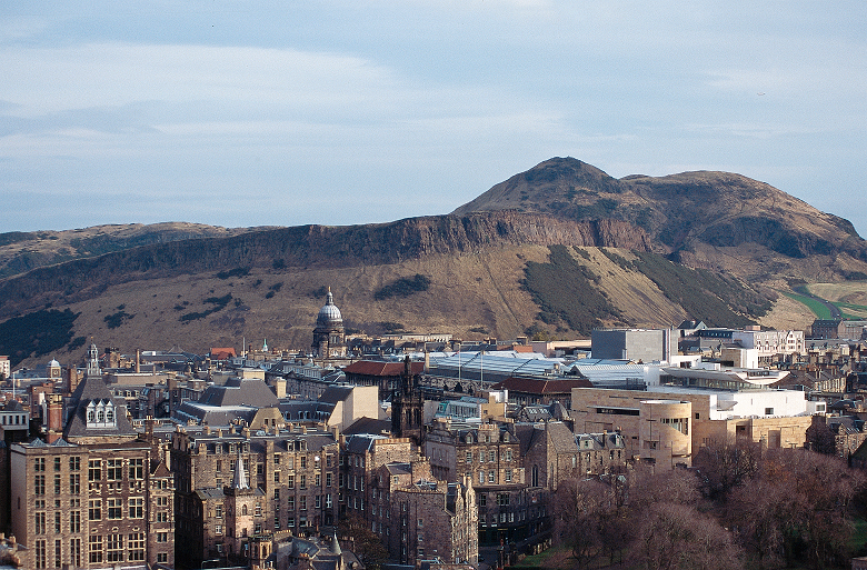 A view of Salisbury Crags in their prominent position above Edinburgh rooftops