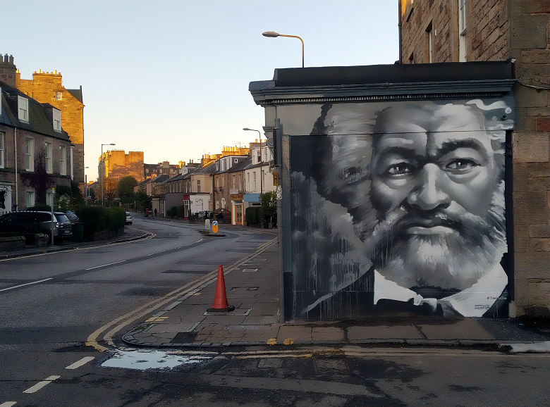 A mural of Frederick Douglass at the end of a residential street