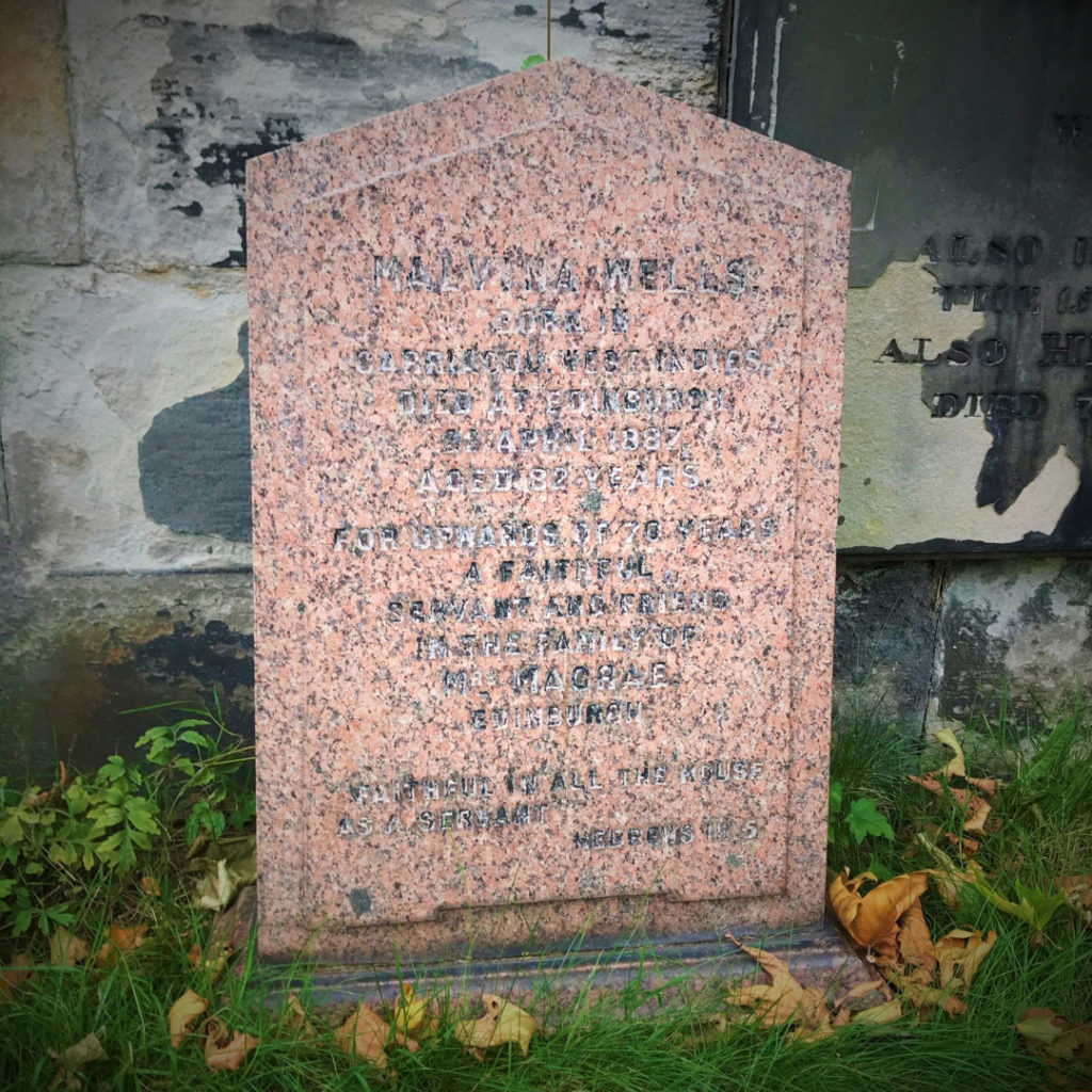 A gravestone which reads: Malvina Wells born in Carriacou West Indies Died at Edinburgh 22 April 1887 Aged 82 years For upwards of 70 years A faithful Servant and Friend In the Family of Mrs MacRae Edinburgh