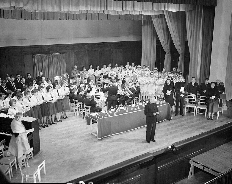 Archive photo of carol singers and an orchestra on stage