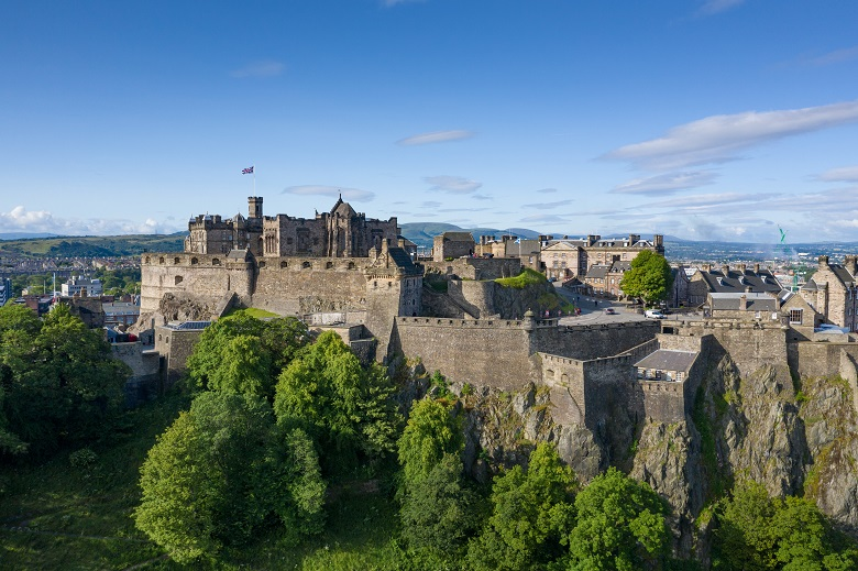An aerial view of Edinburgh Castle perched on a volcanic rock