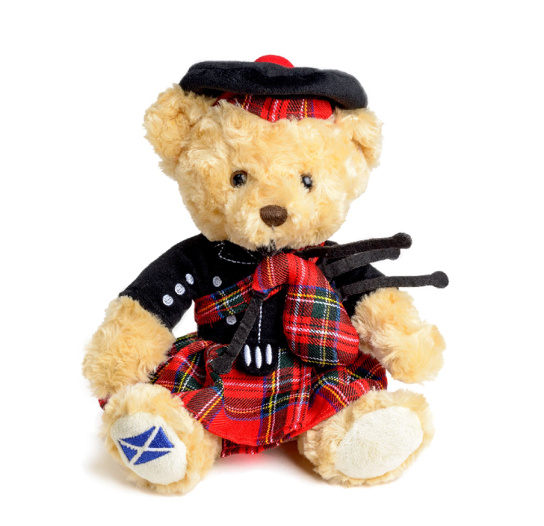 teddy bear in kilt and bonnet holding bagpipes