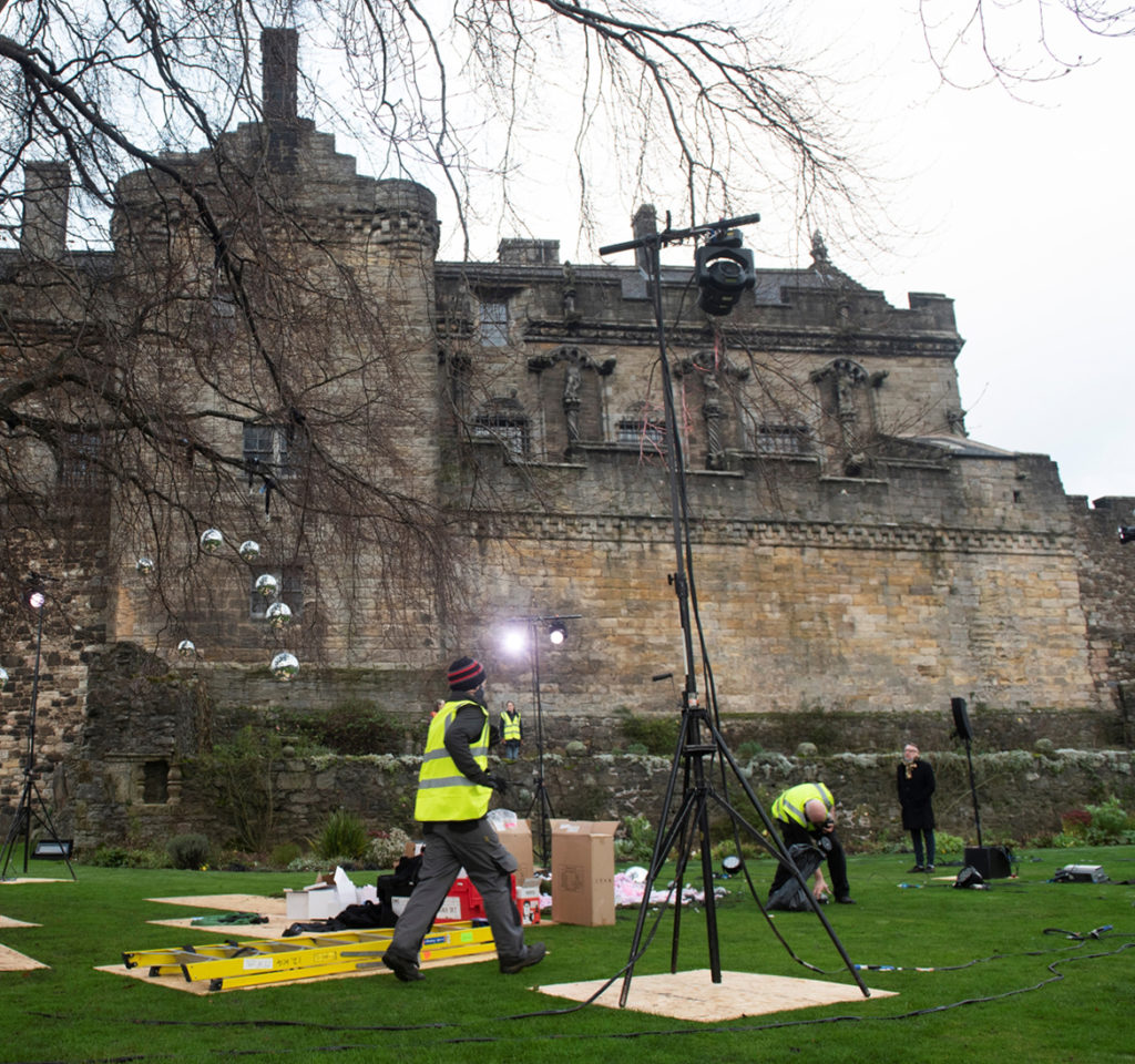 A film set in the gardens of Stirling Castle, with lighting rigs and filming equipment