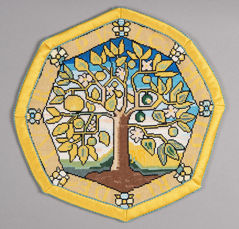 an octagonal embroidered patch featuring an apple tree.