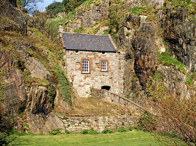 the guardhouse at Dumbarton Castle, built into a narrow natural crevice between two rock faces.