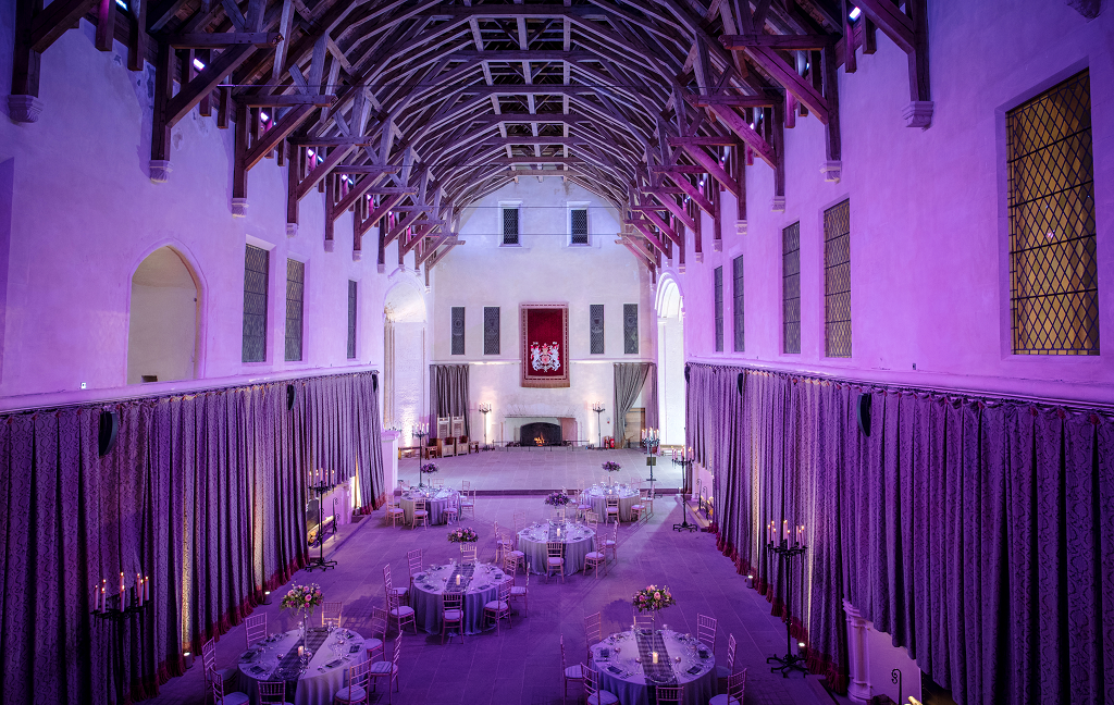 Decorated tables laid out in The Great Hall in Stirling Castle ahead of a wedding
