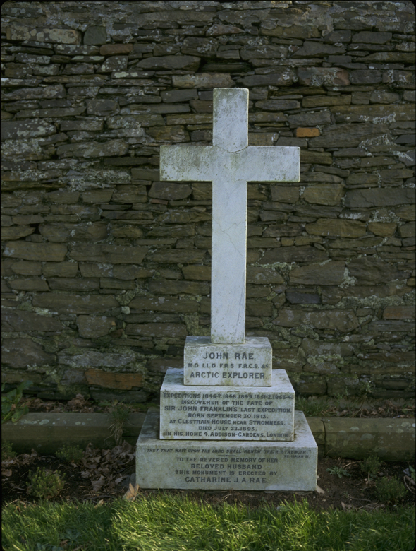 A grave marked by simple white cross