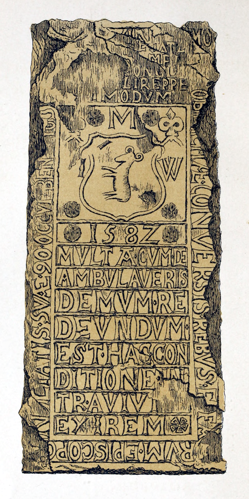 Eroded stone slab on the floor with a shield pattern and epitaph in Latin carved in relief.