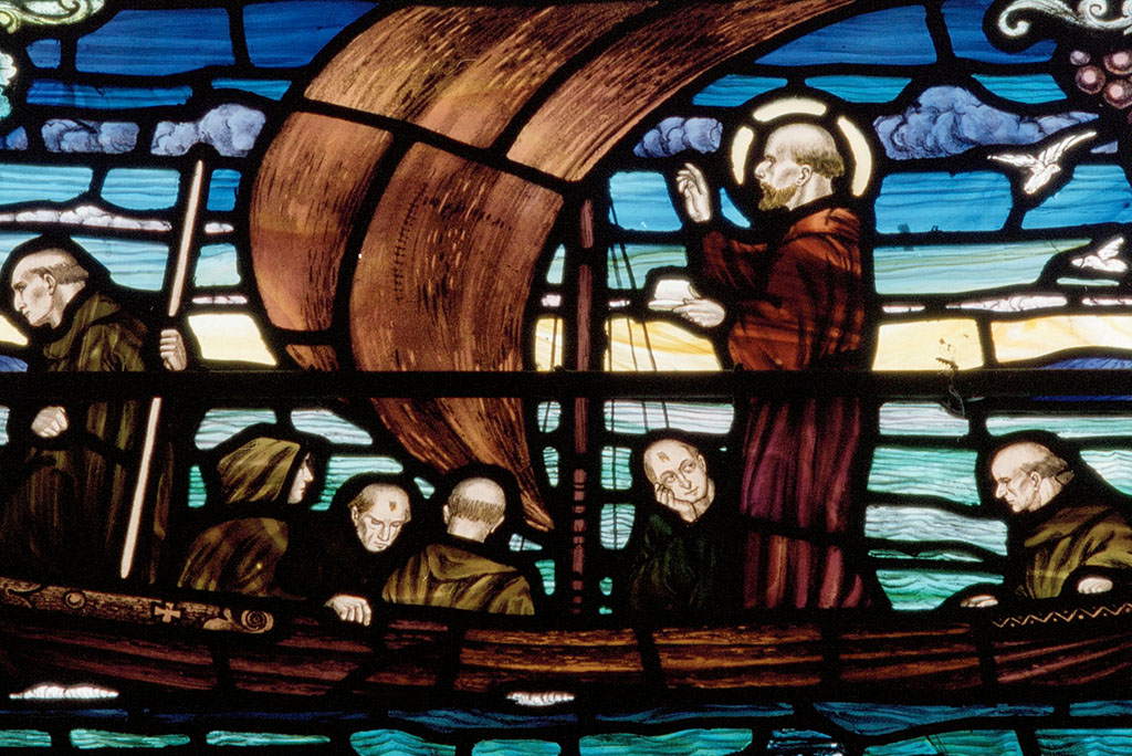 stained glass representation of St Columba and his disciples in a boat
