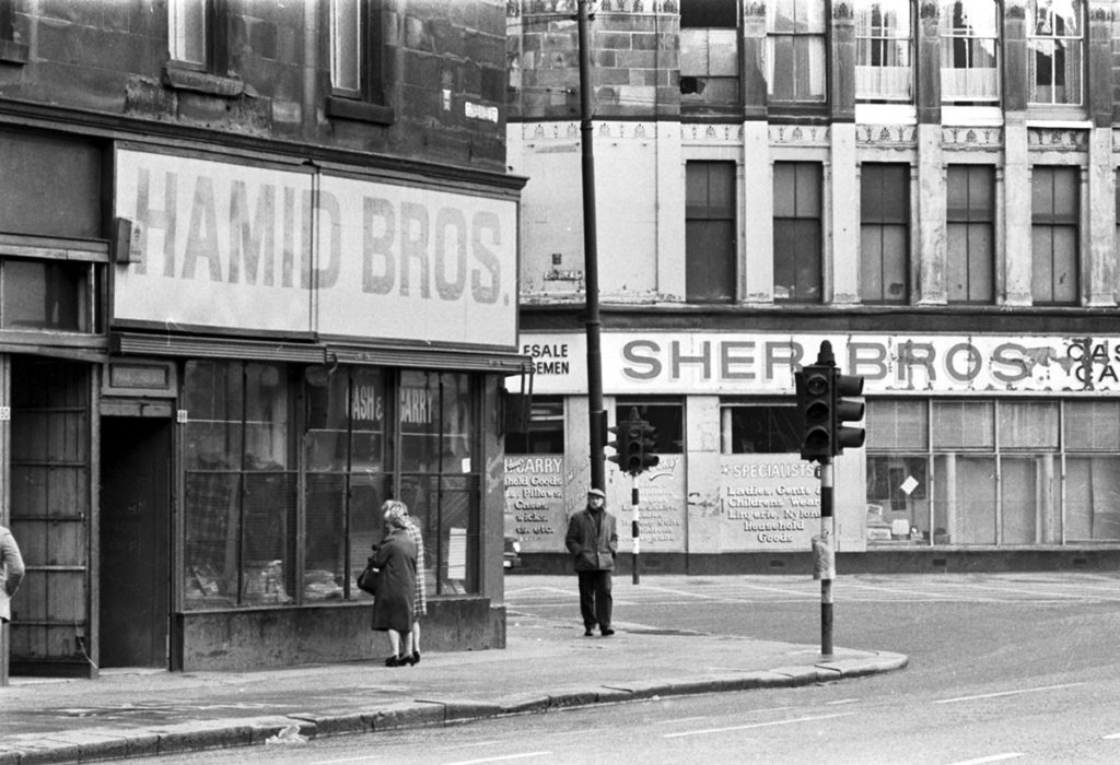 Shop fronts reading Sher Bros and Hamid Bros