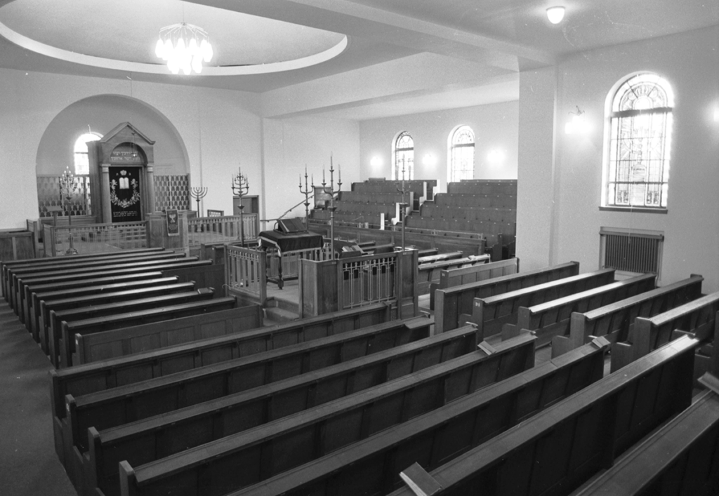 Interior of a synagogue with rows of benches