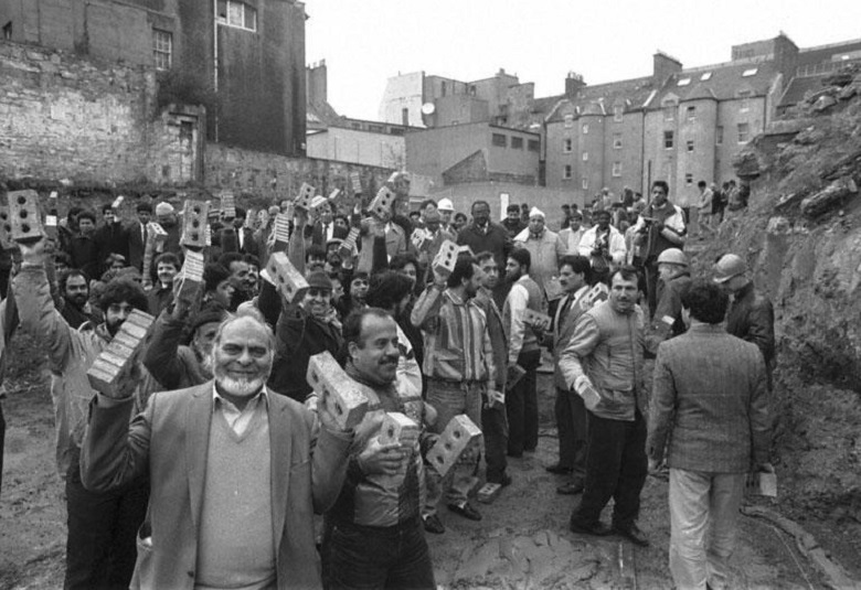 A group of men pictured holding bricks in a ceremony to lay the foundations of Edinburgh Central Mosque
