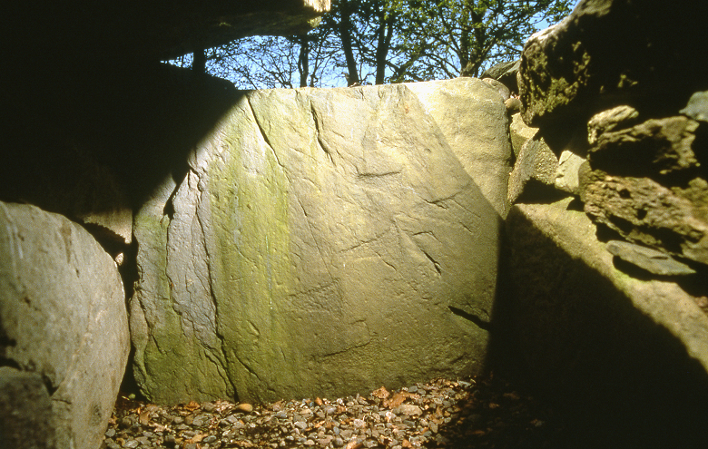 Axe heads carved into a stone slab